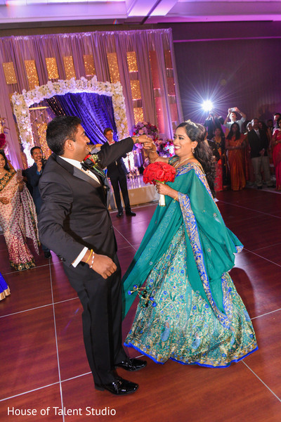 JoyfJoyful indian couple dance photo.