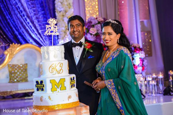 Indian wedding cake cutting fun moment