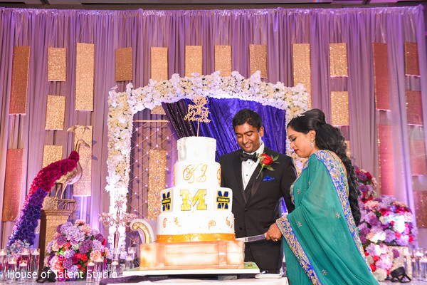 Indian wedding cutting the cake scene.