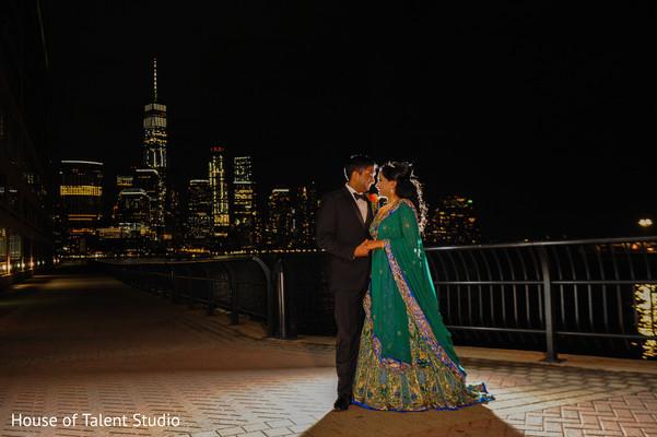 Elegant Indian couple posing for photo.