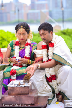 See this lovely Indian couple at their Indian wedding ceremony.