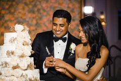 Indian bride and groom cutting the cake