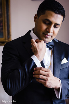 Indian groom getting ready with the tux