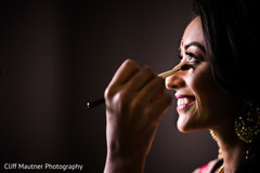 Lovely bride getting her makeup done.