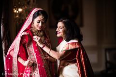 Indian bride putting her sari on.
