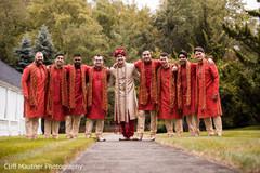 Handsome indian groom with groomsmen