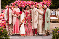 Indian bride and groom with family members.