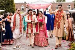 Indian bride making her big entrance to ceremony.