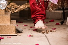 Indian groom stepping on nuts ritual.