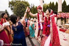 Indian bridesmaid and groom agree to get the mojaris cack.