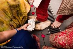 Indian groom putting his mojaris.