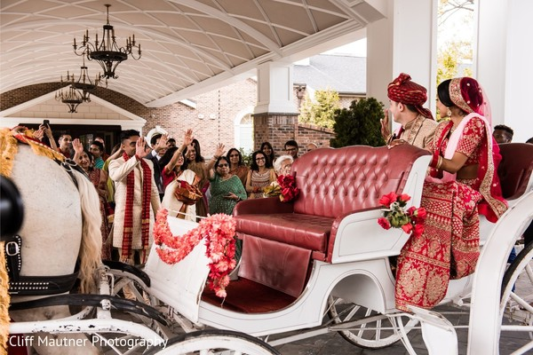 Indian bride and groom on their enchanted carriage.
