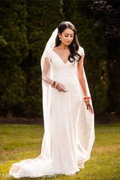 Astonishing Indian bridal on her white dress.