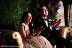 Joyful Indian couple at reception party.