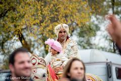 Indian groom looking neat during baraat