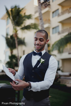 Indian groom reading his vows.