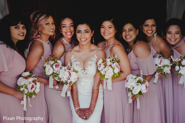 Incredible Indian bride and bridesmaids ready capture.