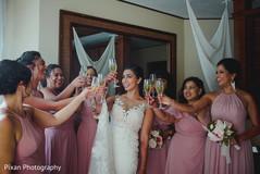 Indian bride and bridesmaids cheering up.