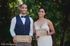 Lovely Indian couple with thank you signs.