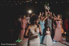 Indian bride throwing her bouquet capture.