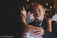 Indian bride dancing with her father capture.