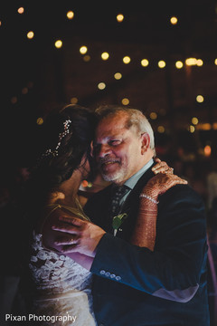 Sweet indian bride dancing with her father.
