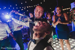 Indian groom having fun capture.