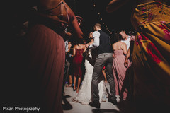 Upbeat bride and grooms dance scene.