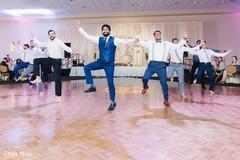 Indian groom and groomsmen performing