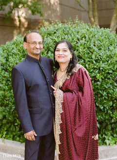 Parents posing for pictures