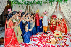 Indian bride and groom with guests