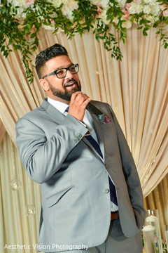 Indian wedding guest delivering a message