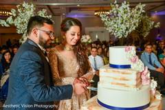 Maharani cutting the cake with Raja