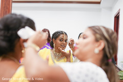 Indian bride getting the final makeup touches
