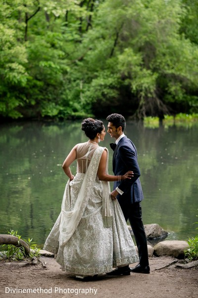 Lovely shot of the couple by the lake