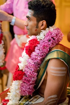 Raja wearing the flower garland