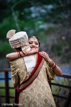 Indian bride and groom hugging