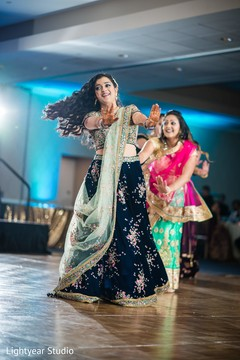 Indian bride dancing during the ceremony