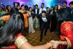 Groom performing with guests