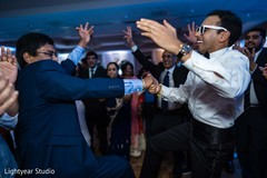 Indian groom having a blast with guests