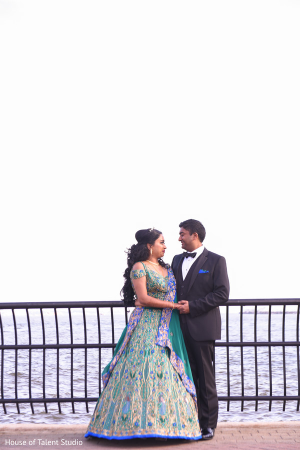 Indian bride and groom by the ocean