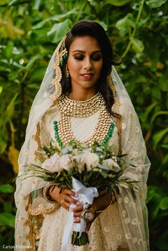 Indian bride holding the bouquet