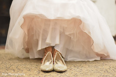Closeup capture of Indian bridal shoes.