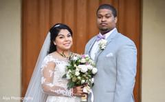 Handsome indian groom with bride.