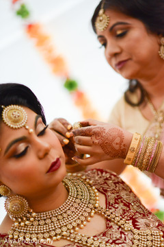 Special capture of Indian bride getting ready.