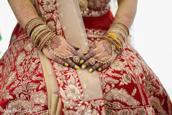 Stunning Indian bridal chooras, Hathphool and mehndi art capture.