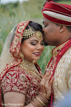 Lovely kiss capture of Indian bride and groom.