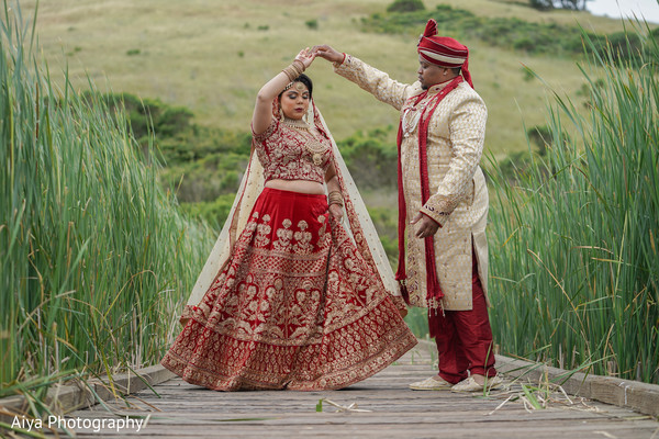 Indian groom admiring bride.