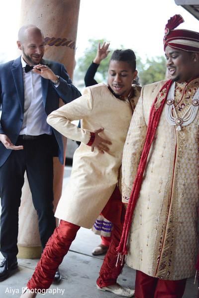 Indian bestmand dancing at baraat.