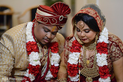See this lovely indian bride and groom at ceremony ritual.
